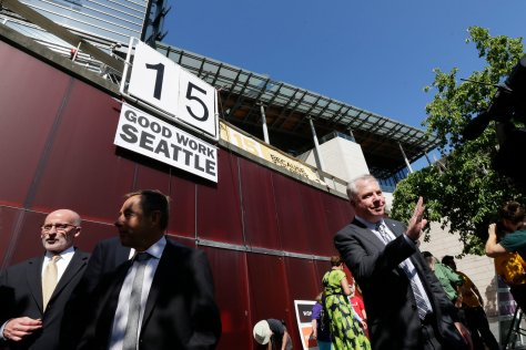 From NYTimes.com: Mayor Ed Murray of Seattle, right, after the City Council approved a minimum wage that is more than double the federal minimum. The $15 rate is the highest among the nation's big cities. Credit Ted S. Warren/Associated Press.