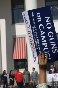 "No Guns: An individual proudly holds up a sign distributed by the Florida College System Student Government Association bearing the exclamation, ""No Guns on Campus!"" TOMÁS MONZÓN\THE REPORTER"