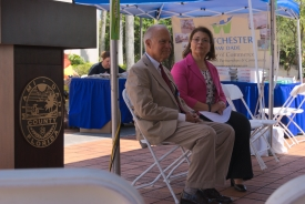 District 10 Commissioner Javier Souto sits next to Miami-Dade Transit Director Ysela Llort at the ribbon-cutting ceremony for the new Westchester Circulator. BY TOMAS MONZON